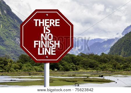There is No Finish Line written on red road sign with landscape background