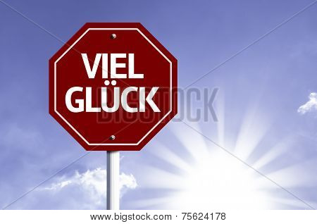 Good Luck (In German) red sign with sun background