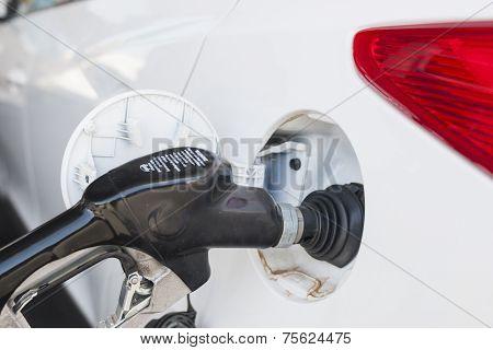 Refilling Car Tank At Fuel Station