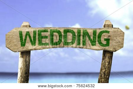 Wedding wooden sign with a beach on background