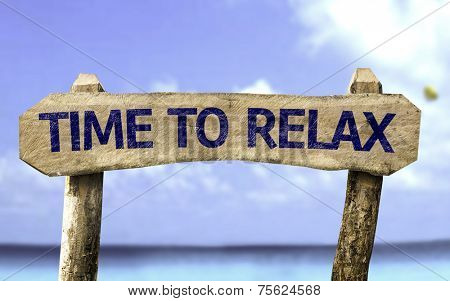 Time To Relax wooden sign with a beach on background