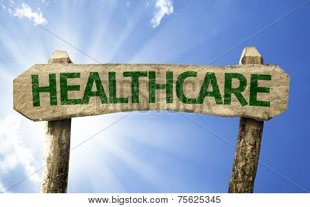 Healthcare wooden sign on a summer day