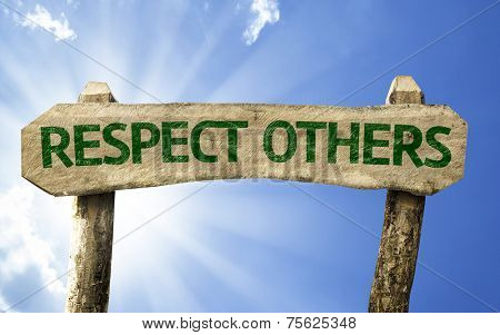 Respect Others wooden sign on a summer day