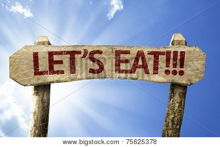 Let's Eat!! wooden sign on a summer day