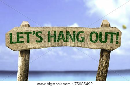 Let's Hang Out! wooden sign with a beach on background