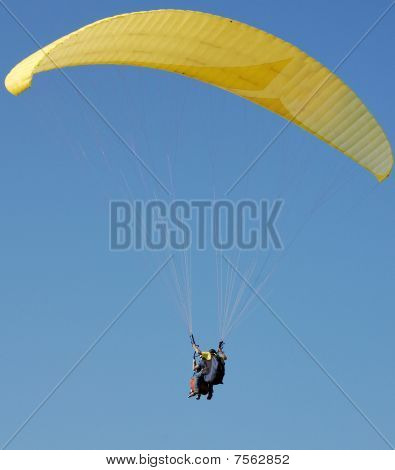 Double Paragliding In Blue Sky