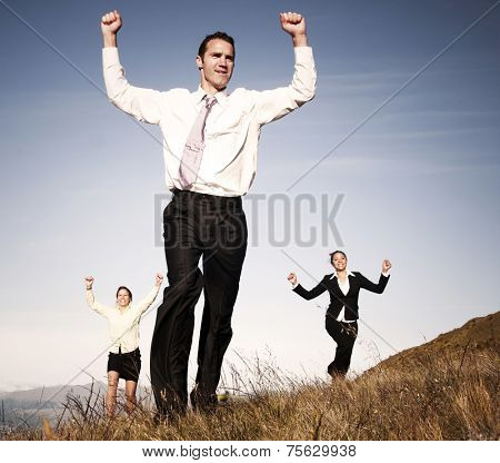 Concept of business people running on the mountain.