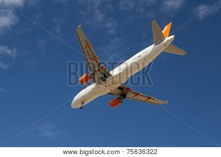 VALENCIA, SPAIN - NOVEMBER 7, 2014: An EasyJet aircraft landing at the Valencia, Spain Airport.  Easyjet is the second largest low-cost airline of Europe.