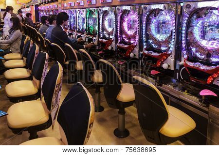 KYOTO, JAPAN, NOVEMBER 15, 2011: Some customers are gambling in a Pachinko hall, traditional Japanese Game in Kyoto, Japan