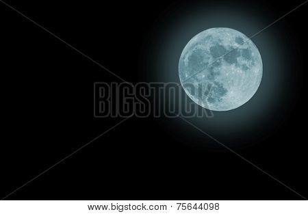 Blue Full moon isolated on a black sky