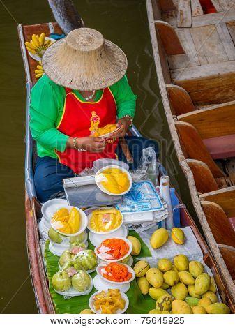 Bangkok, Thailand - October 20, 2014: seller at Amphawa Bangkok floating market at Bangkok, Thailand on October 20, 2014