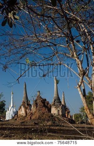 Scenic View Of Buddhist Pagodas On Inle Lake In Myanmar.