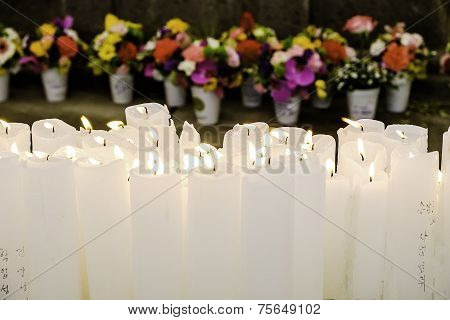 Candles And Flowers In Buddhist Temple