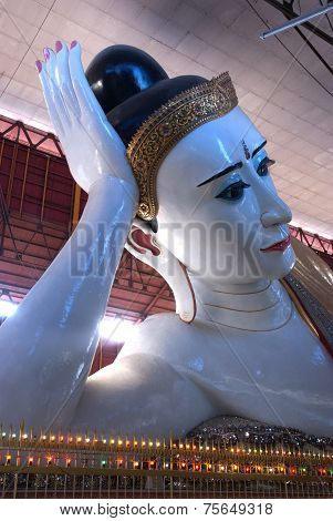 Sweet Eye White Reclining Buddha In Myanmar.