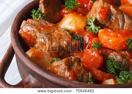 Stew In Tomato Sauce With Vegetables And Herbs Macro. Top View