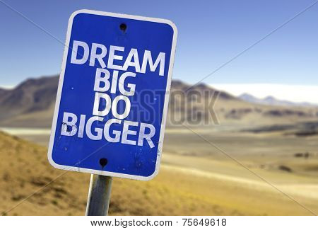 Dream Big Do Bigger sign with a desert background