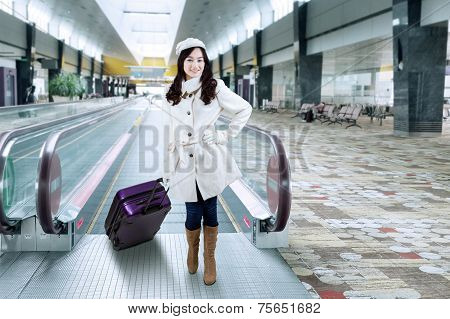 Girl In Winter Coat At Airport Hallway