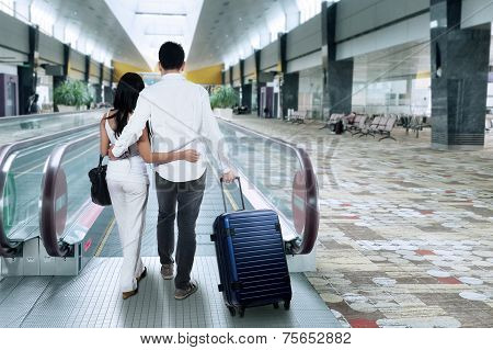 Rear View Of People Walk In Airport Hall