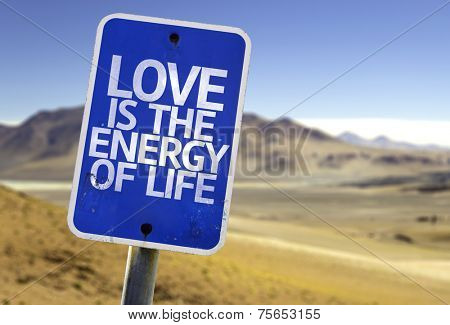 Love is The Energy of Life sign with a desert background