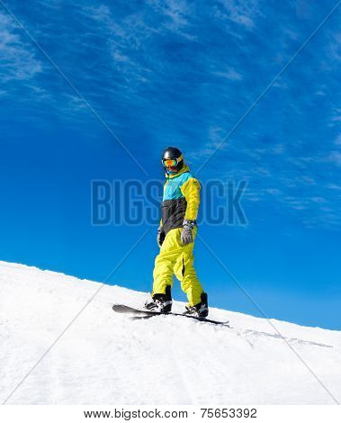 Snowboarder down hill, snow mountains snowboarding