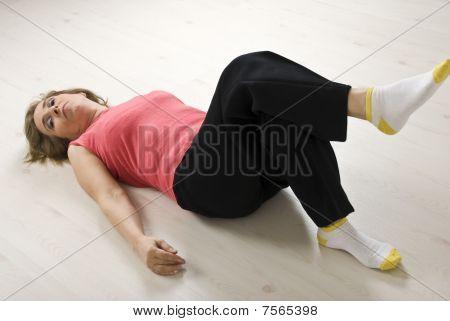 Senior Woman Relaxing On Floor