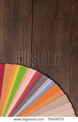 Color Catalogue On Wooden Desk
