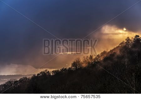 Sunset In The Foggy Evening
