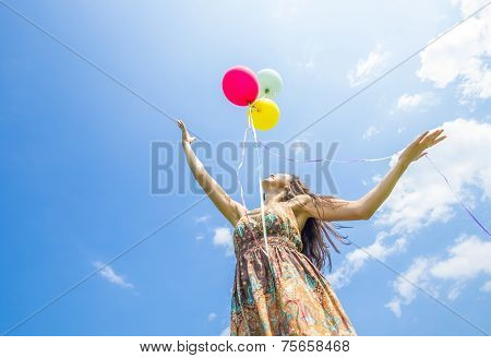 Woman Releasing Balloons