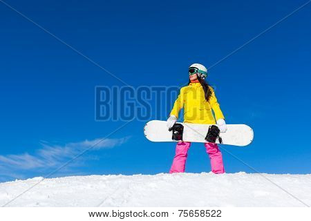 snowboarder girl standing hold snowboard, snow mountain slope