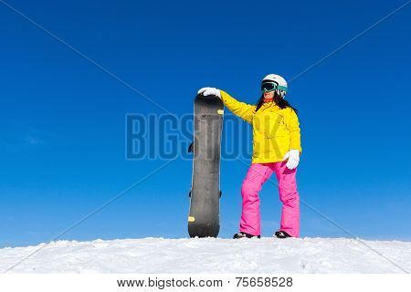 snowboarder standing hold snowboard