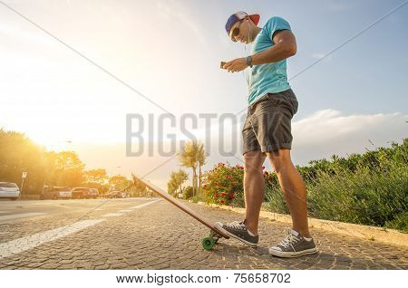 Man On Longboard At Sunset