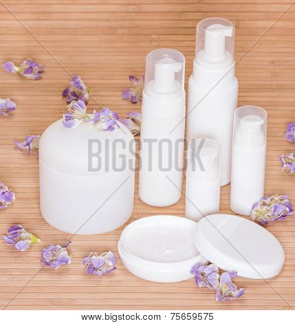 Open Jar Of Cream And Other Body Care Cosmetics With Flowers