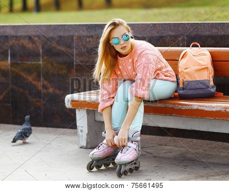 Extreme, Fun, Youth And People Concept - Pretty Stylish Blonde Girl In Sunglasses With Roller Skates