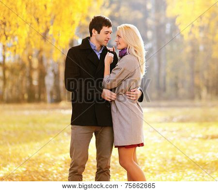 Autumn, Love, Relationships And People Concept - Lovely Young Couple In Love Outdoors In Sunny Autum