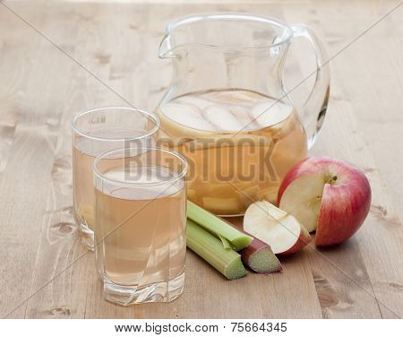 Compote Of Rhubarb And Apple In A  Glass Jugful  And Two Glasses.