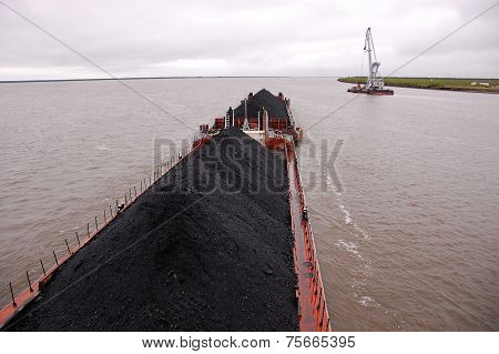 Cargo Ship With Coal At Kolyma River Russia Outback