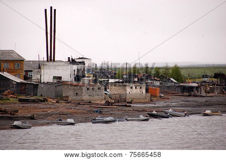 Village At Kolyma River Coast Outback Russia