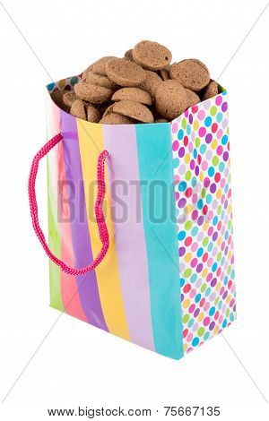 Colorful Bag Filled With Ginger Nuts Over White