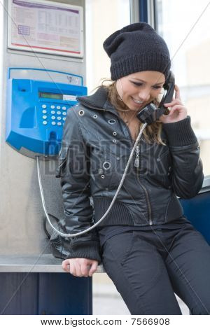 The Young Girl In Telephone Booth