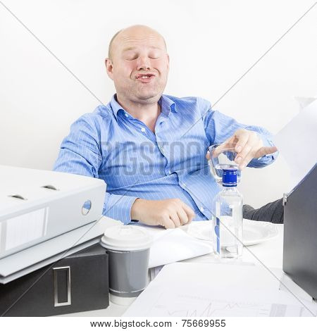 Drunk businessman at the office