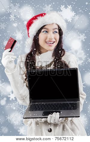 Woman In Winter Coat Holding Laptop And Credit Card