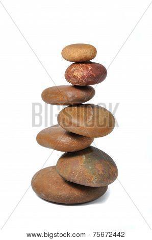 Balanced stones over white
