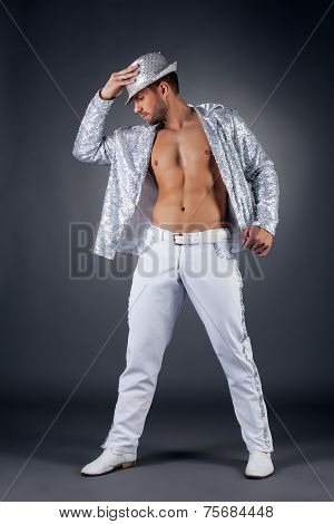 Bearded striptease dancer posing in shiny suit