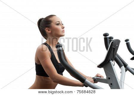 Beautiful girl exercising on stationary bike
