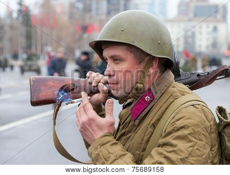 Samara, Russia - November 7, 2014: Member Of Historical Reenactment In Soviet Army Uniform After Bat