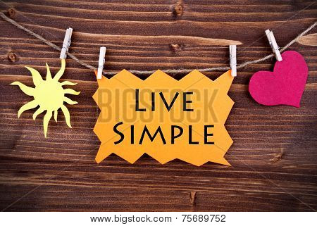 Orange Lable Saying Live Simple