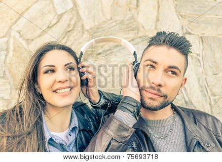 Couple Listening Music With Earphone