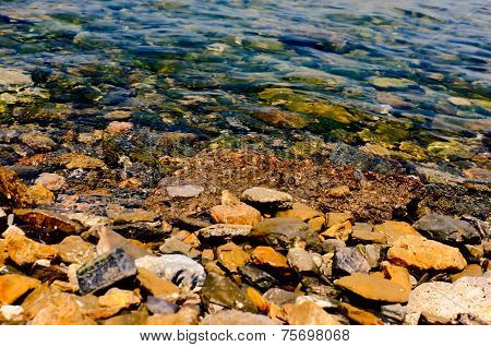 Shallow water with stones inside