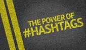 stock photo of hash  - The Power Of Hashtags written on the road - JPG