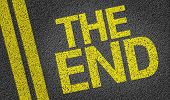 stock photo of day judgement  - The end written on the road - JPG